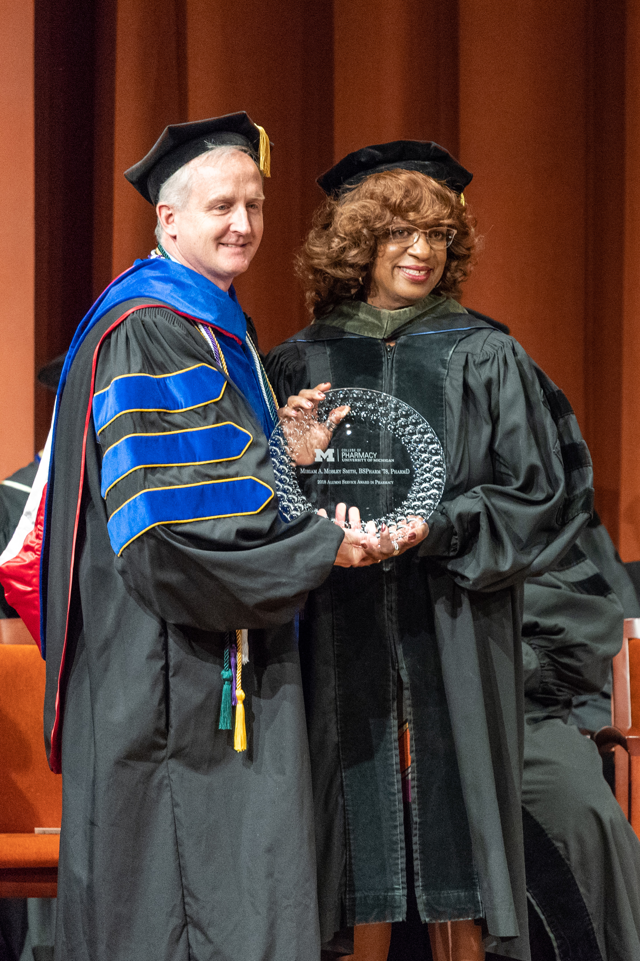 Dean James Dalton with Dr. Miriam Mobley Smith at the 2018 U-M Pharmacy commencement ceremony.