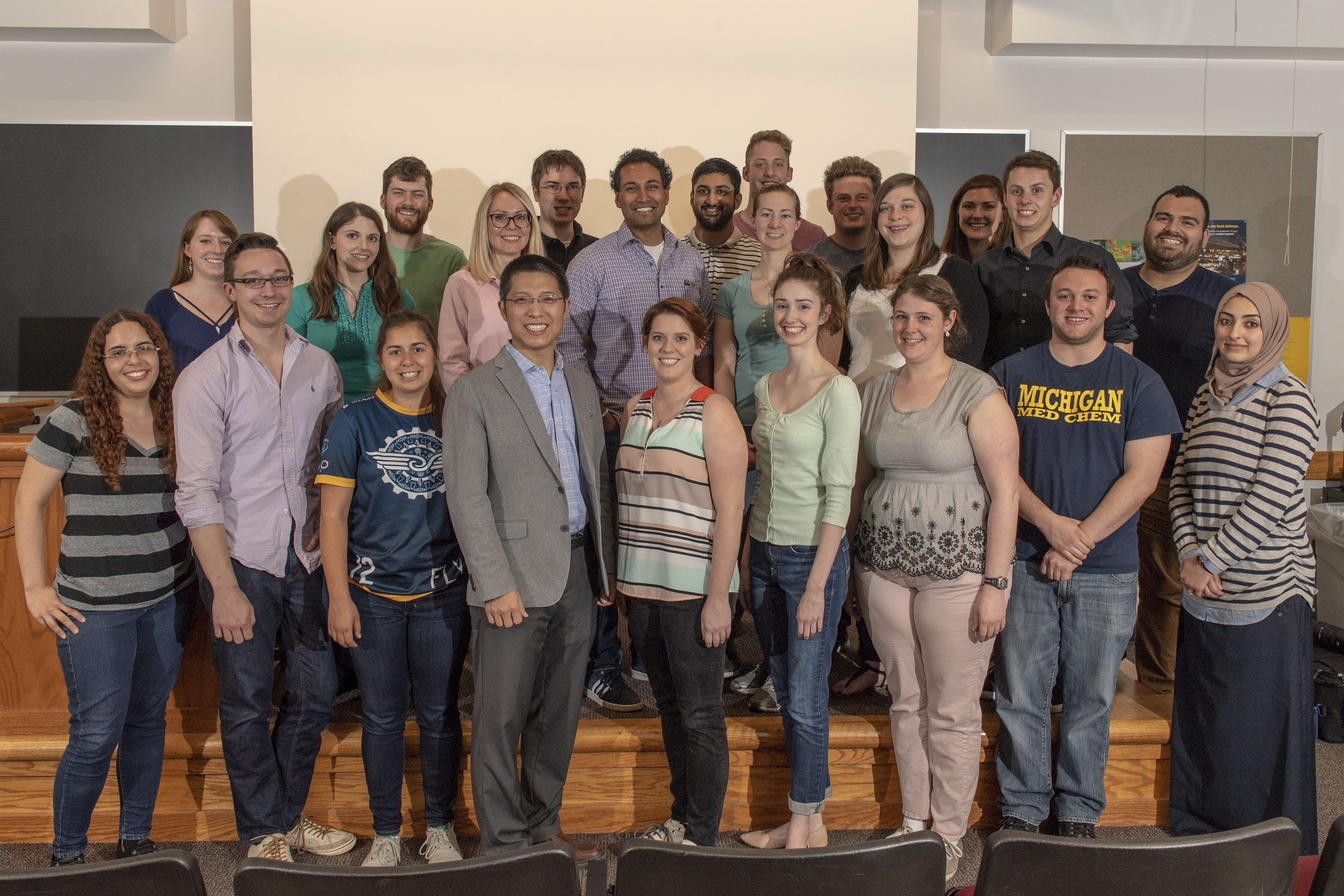 U-M MedChem students with alumnus Yousong Ding.