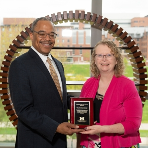 Dr. Paul Walker (left) presents the Preceptor of the Year award to Dr. Gay Alcenius