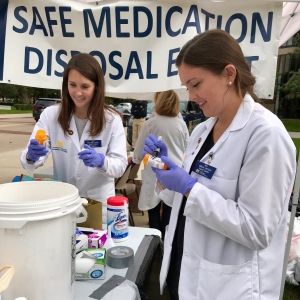 Students collect medication during the College's Safe Medication Disposal Event