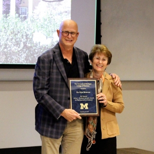 Dr. David Smith presents Kim L.R. Brouwer with the Allen J. Sedman Lecture award.
