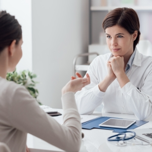 Pharmacist and patient discuss medication