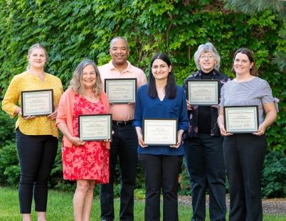 Members of the Office of Experiential Education and Community Engagement with their certificates from AACP