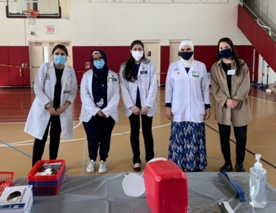 Faculty and student volunteers at the COVID vaccination clinic
